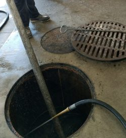 drain being cleaned